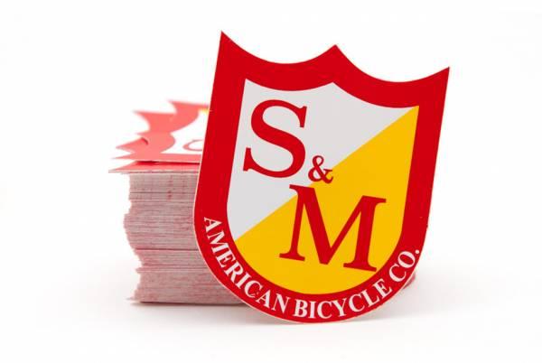 S&M STICKER SHIELD LOGO SINGLE Red/White/Yellow